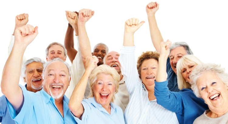 Group of happy senior citizens with their hands raised over white